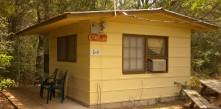 CABIN 10 – 1 room, 1 Queen-size Bed, Dorm Refrigerator, Coffee Pot, Local TV, A/C, Outdoor Shower, and IndoorToilet.