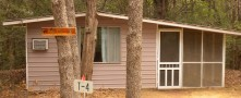 CABIN 3 – 1 room, Queen Size Bed, Dorm Refrigerator, Microwave, Coffee Pot, Toaster, Local TV A/C, Inside Toilet, Inside Shower, Screen-In Porch.  No Smoking indoors Please.