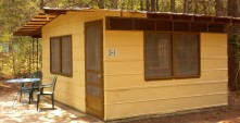 CABIN 5 - 1 room, 1 Queen Size Bed, Dorm Refrigerator, Microwave, Toaster, Chair, Table & 2 Chairs, Inside Toilet, Outdoor Shower, Indoor Sink, Local TV, A/C, Electric Heat.