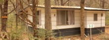 CABIN 8 – Queen Size Bed, Dorm Refrigerator, Gas Stove, Coffee Pot, Microwave, Toaster, Indoor Shower w/ Toilet, Table & 2 chairs, 2 easy chairs, Local TV, A/C, Screened-In Porch